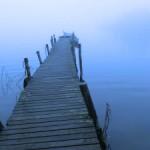 a bridge into a lake in blue